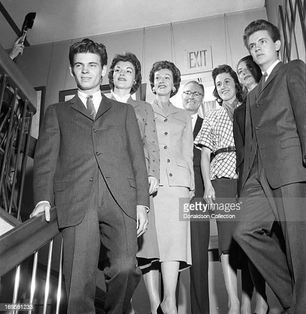Brothers Don Everly and Phil Everly of the rock and roll group Everly Brotherspose for a portrait with attendees at a Cadence Records party at Al and...