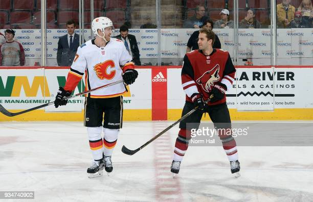Brothers Dougie Hamilton of the Calgary Flames and Freddie Hamilton of the Arizona Coyotes talk prior to a game at Gila River Arena on March 19 2018...