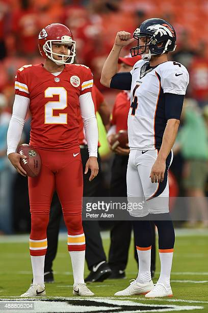 Brothers Dustin Colquitt of the Kansas City Chiefs and Britton Colquitt of the Denver Broncos talk during pregame at Arrowhead Stadium on September...