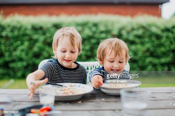 Brothers eating
