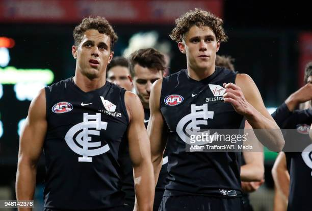 Brothers Ed and Charlie Curnow of the Blues look dejected after a loss during the 2018 AFL Round 04 match between the North Melbourne Kangaroos and...