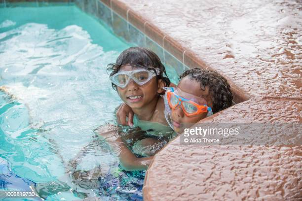 Brothers embracing in pool