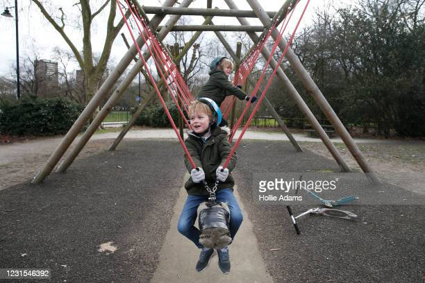 Brothers Freddie Wallace and Jacob Wallace at the Victoria Park playground on March 6, 2021 in London, England. Londoners are enjoying bright weather...