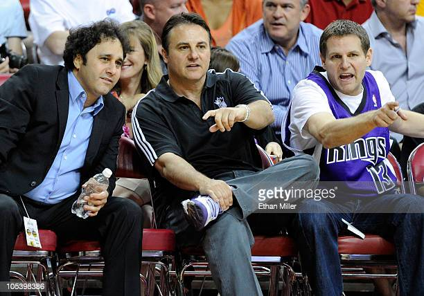 Brothers George Maloof, Gavin Maloof and Joe Maloof watch a preseason game between the Sacramento Kings and the Los Angeles Lakers at the Thomas &...