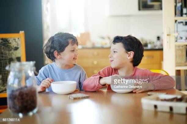 2 brothers having their breakfast - cereal plant stock pictures, royalty-free photos & images