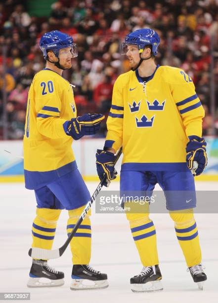 Brothers Henrik Sedin and Daniel Sedin of Sweden talk during the ice hockey men's preliminary game against Belarus on day 8 of the Vancouver 2010...
