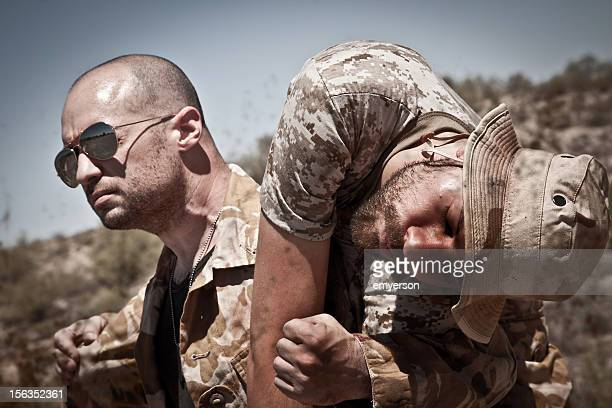 brothers in arms - wounded soldier stock photos and pictures