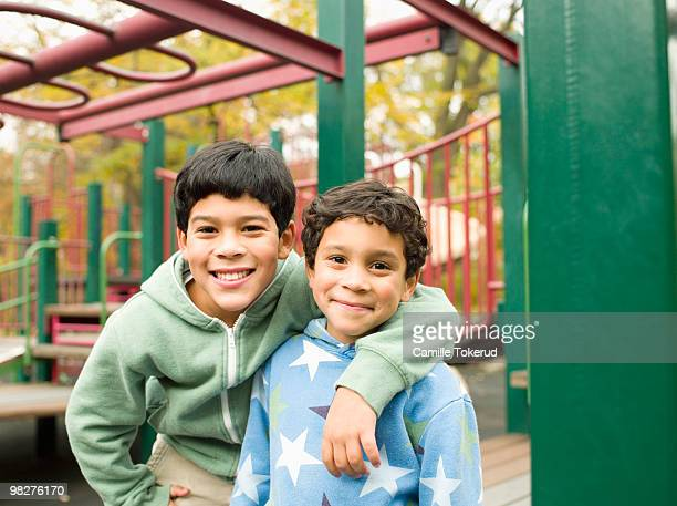 Brothers in playground.
