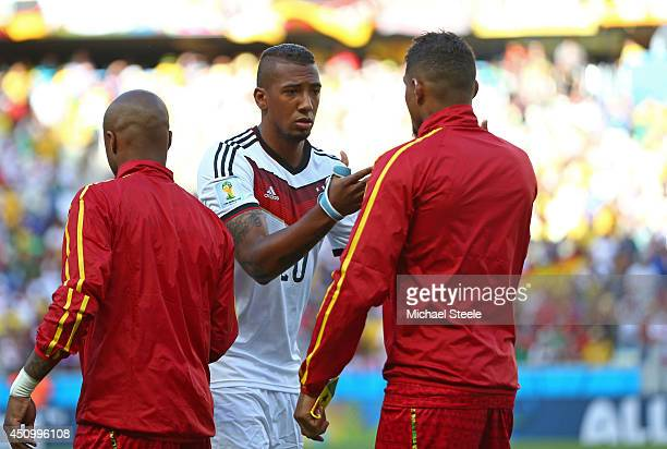 Brothers Jerome Boateng of Germany and KevinPrince Boateng of Ghana shake hands prior to the 2014 FIFA World Cup Brazil Group G match between Germany...