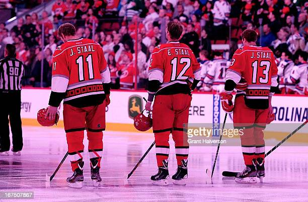 Brothers Jordan Staal Eric Staal and Jared Staal of the Carolina Hurricanes take the ice for the opening faceoff agaist of the New York Rangers at...