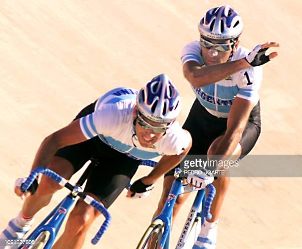 Brothers Juan and Gabriel Curuchet of Argentina drive en route to their gold medal during the 60 kms cycling event 31 July 1999 at the Pan Am Games...