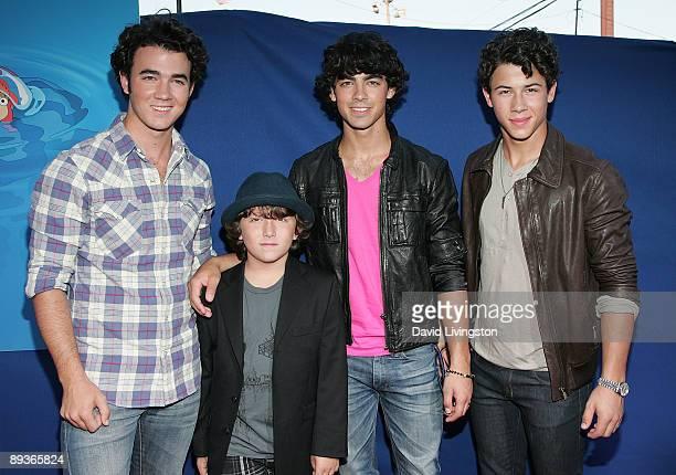 Brothers Kevin Jonas cast member Frankie Jonas Joe Jonas and Nick Jonas attend an industry screening of Walt Disney Pictures' Ponyo at the El Capitan...
