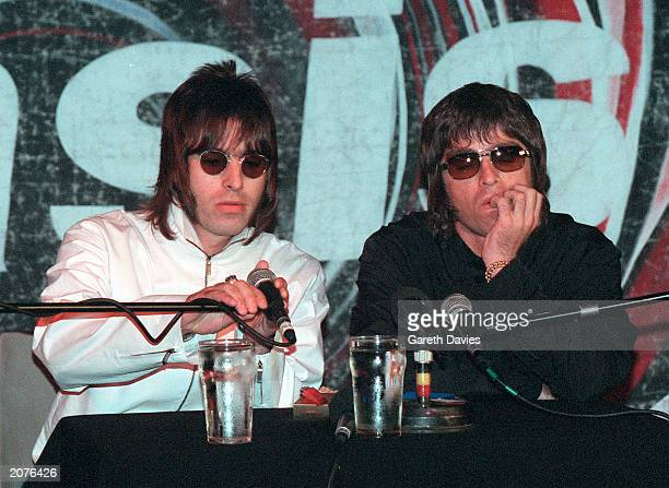 Brothers Liam and Noel Gallagher from Oasis at a press conference held in the Waterrats pub in London August 25 1999 The conference was called to...