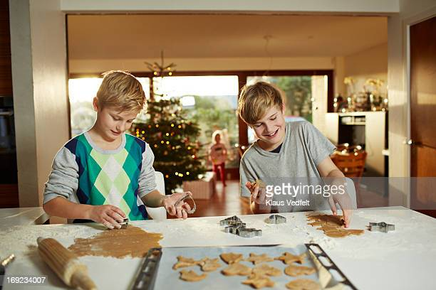 Brothers making christmas cookies