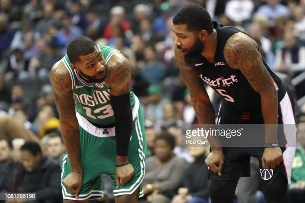 Brothers Marcus Morris of the Boston Celtics and Markieff Morris of the Washington Wizards talk during a foul shot in the second half at Capital One...