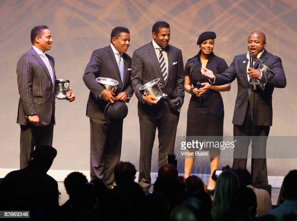Brothers Marlon Tito Jackie and Randy Jackson appear onstage with sister singer Janet Jackson as they receive the BMI Icon Award at the 8th Annual...