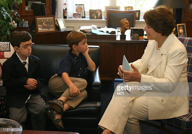WASHINGTON DC Brothers Michael left and Joshua Weiner talk with Rep Anna Eshoo in her office on Capitol Hill on Wednesday June 23 2005 The boys are...