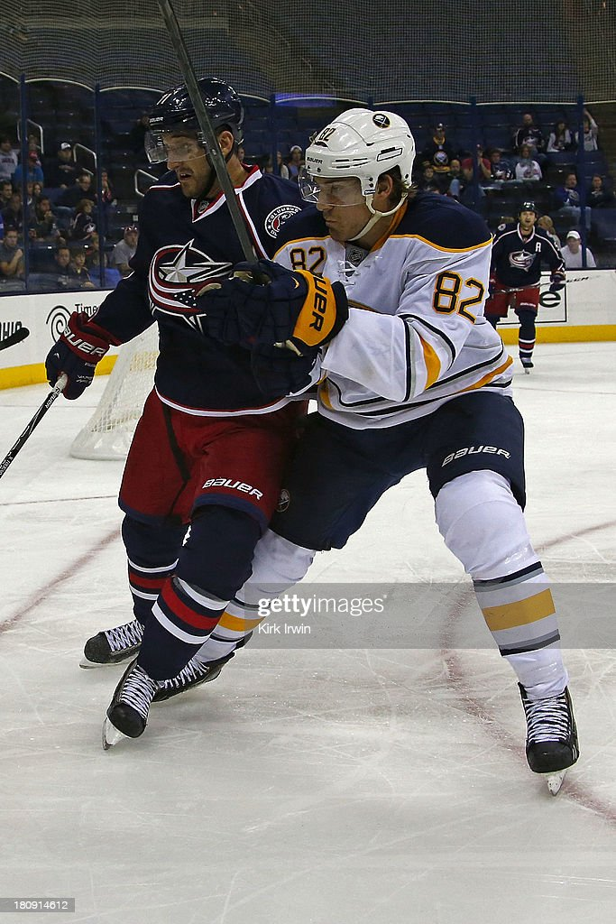 Brothers Nick Foligno #71 of the Columbus Blue Jackets and Marcus Foligno #82 of the Buffalo Sabres chase after a loose puck during the third period on September, 2013 at Nationwide Arena in Columbus, Ohio.