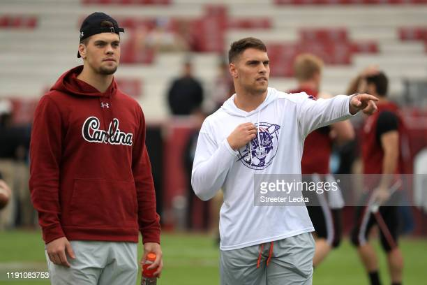 Brothers Nick Muse of the South Carolina Gamecocks and Tanner Muse of the Clemson Tigers talk before their game at WilliamsBrice Stadium on November...