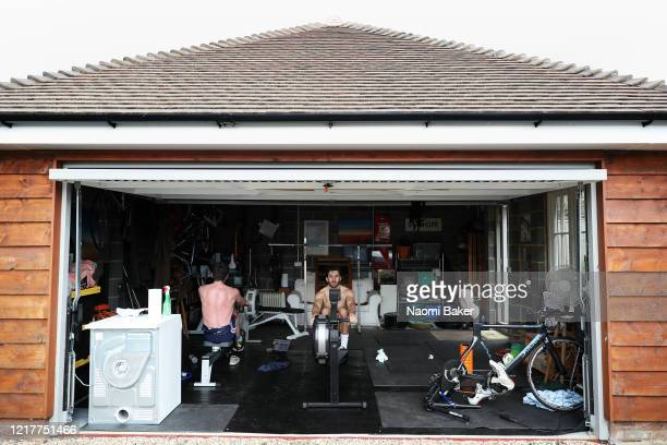 Brothers Oliver Stanhope and James Stanhope train in their garage at home on April 01 2020 in Caversham England The coronavirus and the disease it...