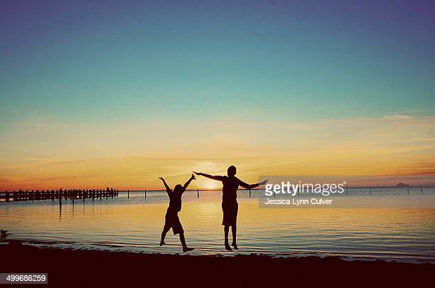 brothers on a beach - lynn pleasant stock pictures, royalty-free photos & images