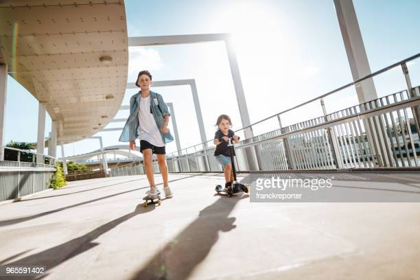 brothers on the street in brisbane - brisbane stock pictures, royalty-free photos & images