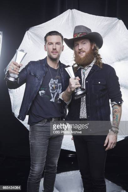 Brothers Osborne pose for a photograph in the CBS Photo Booth backstage at THE 52ND ACADEMY OF COUNTRY MUSIC AWARDS broadcast LIVE from TMobile Arena...
