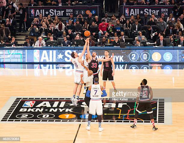 Brothers Pau Gasol of the Eastern Conference AllStar Team and Marc Gasol of the Western Conference allStar Team jump for the tip ball during the 64th...