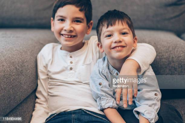 brothers - sibling stock pictures, royalty-free photos & images