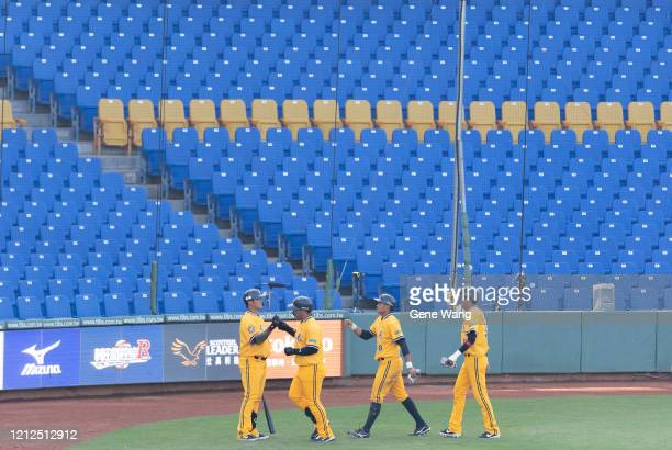 Brothers player cheer during the CPBL preseason game between CTBC Brothers and Wei Chuan Dragons at the Taichung Intercontinental Baseball Stadium on...
