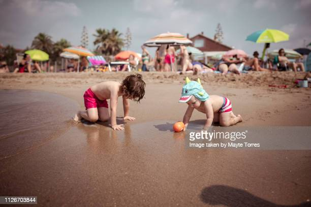 brothers playing at the seashore - autism awareness stock pictures, royalty-free photos & images