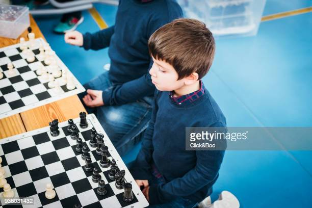 Brothers playing chess