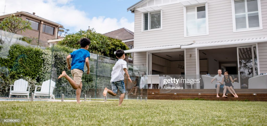 Brothers playing outdoors in spring : Stock Photo