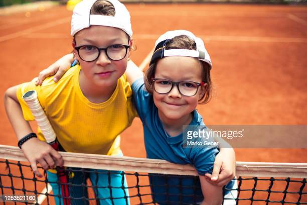 brothers playing tennis - doubles stock pictures, royalty-free photos & images