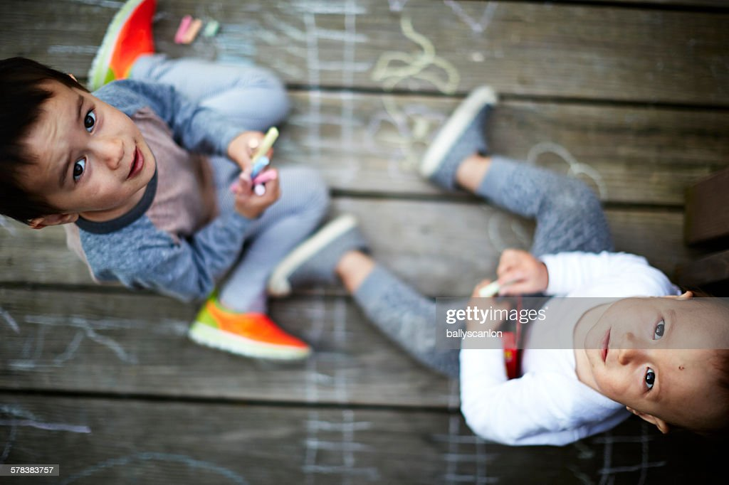 Brothers playing with chalk : Stock Photo