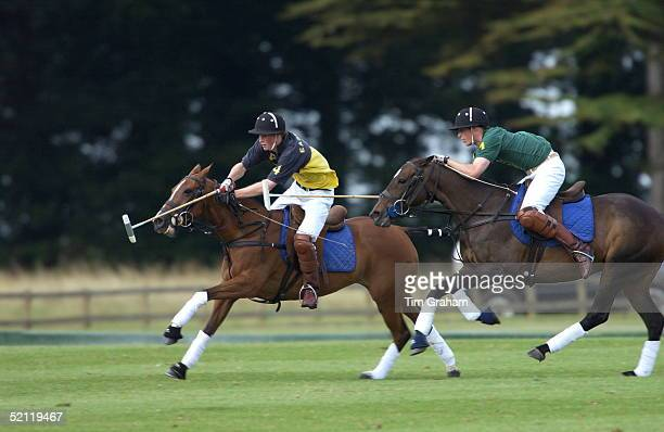 Brothers Prince William And Prince Harry Galloping In Polo Action As They Play In Opposing Teams At Cirencester Park Polo Club. The Match Was...