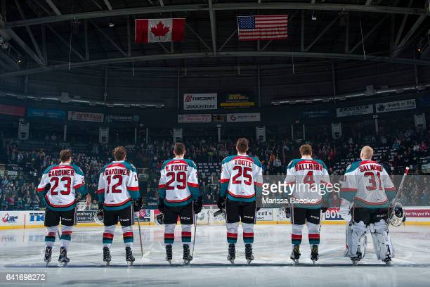 Brothers Reid Gardiner and Erik Gardiner and Nolan Foote and Cal Foote Gordie Ballhorn and Brodan Salmond of the Kelowna Rockets face the flag during...