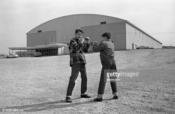 Brothers Robert and Danny Morrison of Lewiston strike a fight pose for the photographer in front of the Central Maine Youth Center The championship...