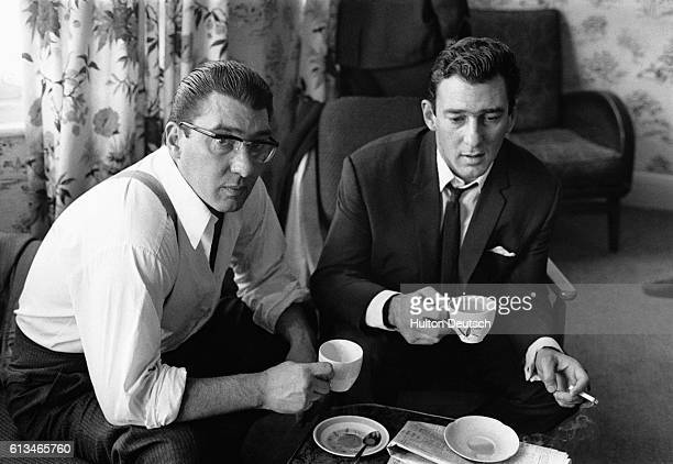 Brothers Ronnie and Reggie Kray drink tea at home in London after spending 36 hours helping the police with their enquiries regarding the murder of...