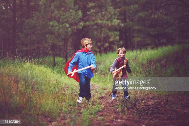 brothers running - sword stock pictures, royalty-free photos & images