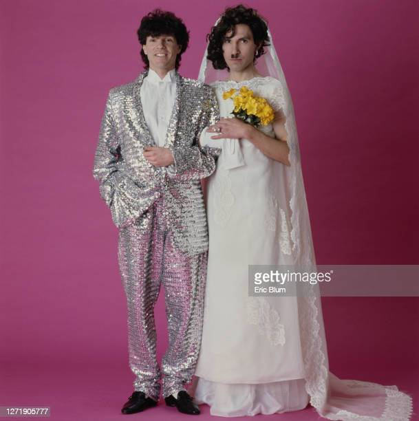 Brothers Russell and Ron Mael of American rock group, Sparks, dressed as a bride and groom, 1982. The shot was used for the cover of their 11th...