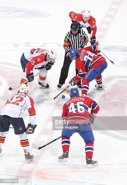Brothers Sergei Kostitsyn and Andrei Kostitsyn of the Montreal Canadiens face off against Olli Jokinen, Jozef Stumpel and Rostislav Olesz of the...
