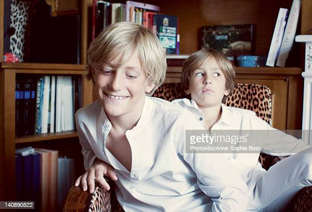 Brothers sitting in armchir, portrait
