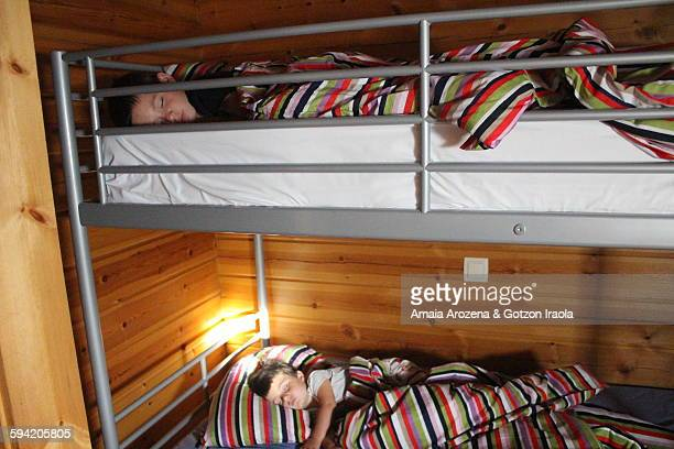 Brothers sleeping in bunk beds