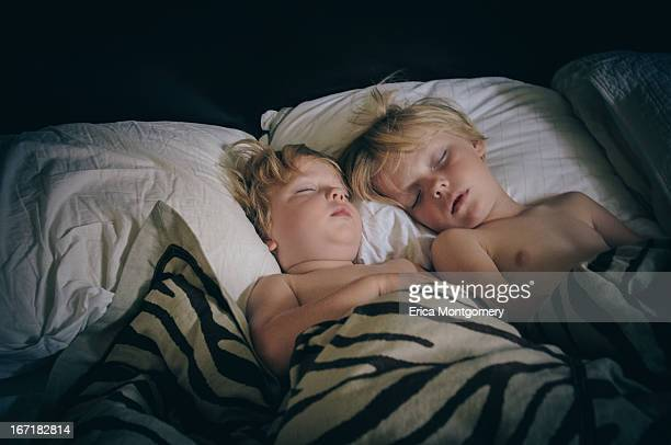 brothers (4-7) sleeping in parents bed