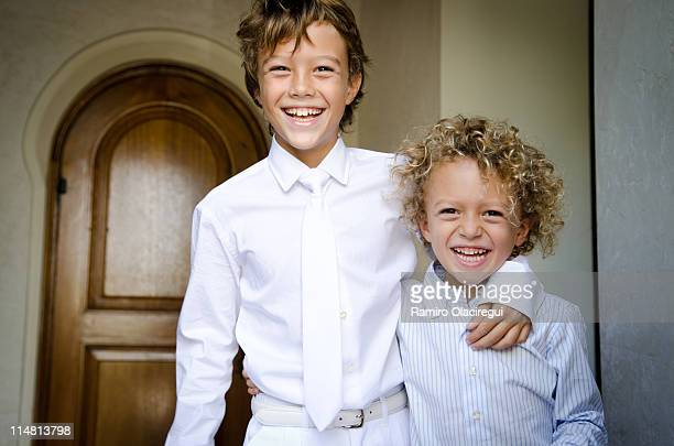 Brothers smiling first communion