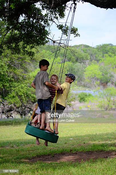 brothers swinging - lynn pleasant stock pictures, royalty-free photos & images