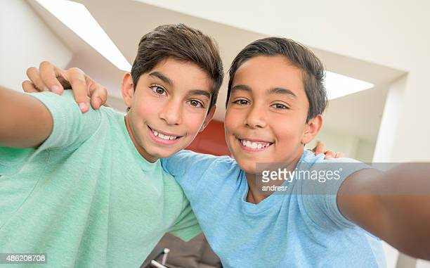 Brothers taking a selfie