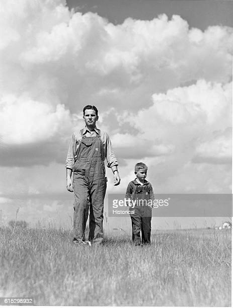 Brothers Tom and Gene tour a farm near Ames Iowa Gene is a student at Iowa State College May 1942