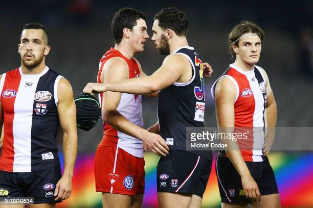 Brothers Tom McCartin of the Swans and defeates Paddy McCartin of the Saints hug during the round 12 AFL match between the St Kilda Saints and the...